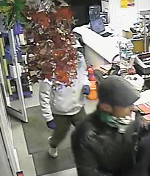 CAUGHT ON CAMERA: The two robbers are seen on a series of CCTV images on the premises of Colley Motor Group, Maendy Way, Cwmbran