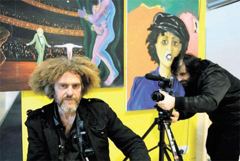 DOCUMENTARY: Artist Jon Sherwood being filmed by Massimo Salvato at the former MFI building on 28 East Retail Park in Newport