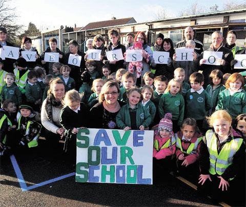 PROTEST: Staff and pupils at Kemys Fawr School making their views known in December last year
