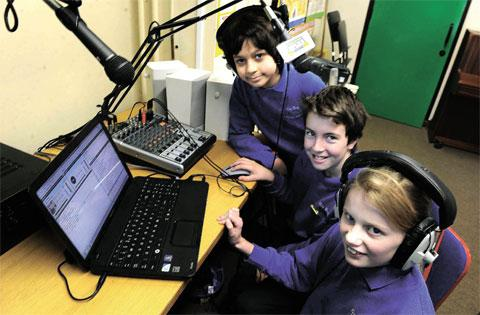 LESSON IN LISTENING: Pupils from left Adam Golaup, Morgan Bedford and Martha Molloy broadcasting on the Dell Primary School's radio station
