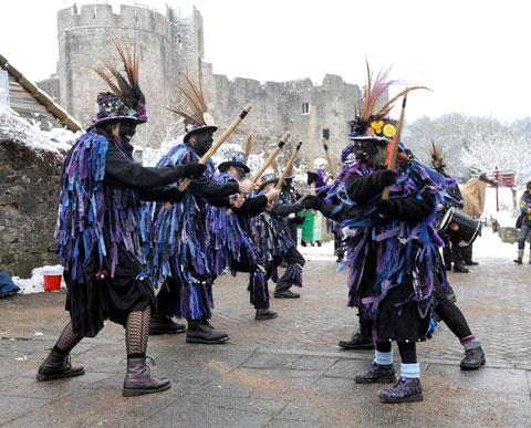 South Wales Argus: CELEBRATION: The Chepstow-based Widders at their Wassail and Mari Lwyd event