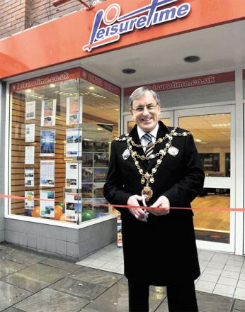 OPEN FOR BUSINESS: Newport mayor Cllr John Guy cuts the ribbon to open the new Leisuretime sales office