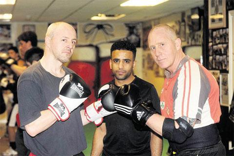 CHALLENGE: Charity fundraiser Mike Williams, right is having a rematch with Lee Ridge, left pictured with trainer Mo Nasir