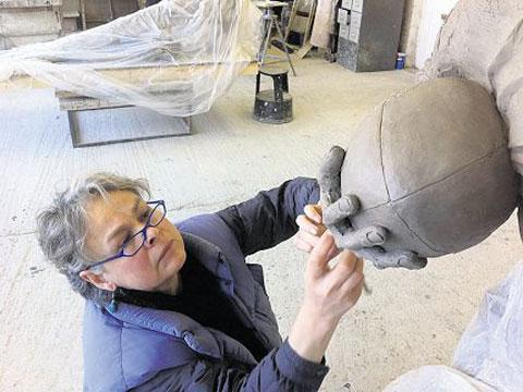 SPORTING LIKENESS: Laury Dizengremel working on the Ken Jones clay model