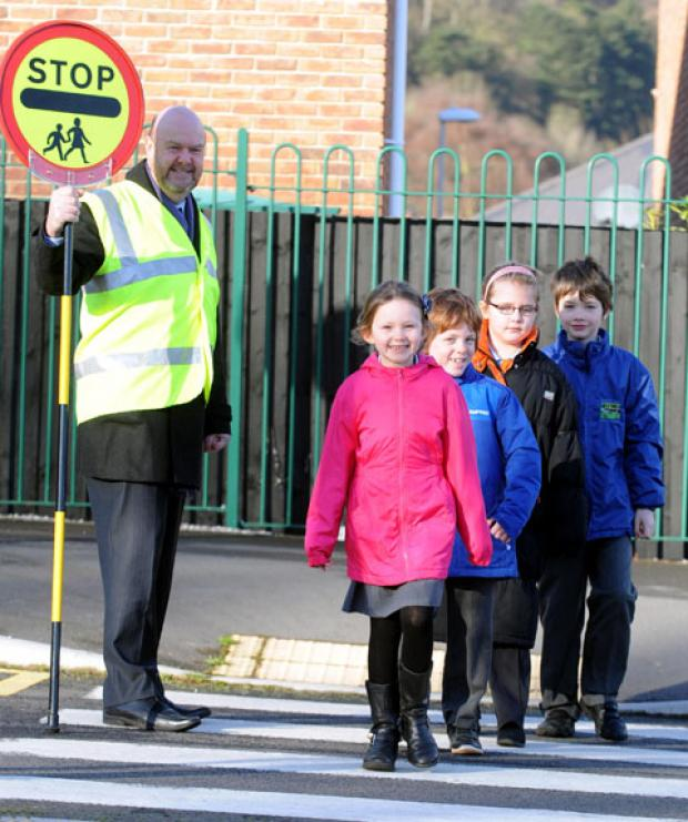 ON PATROL: Jon Murphy, head teacher of Llanfoist Fawr Primary School, stood in as a lollipop man to help pupils cross the road