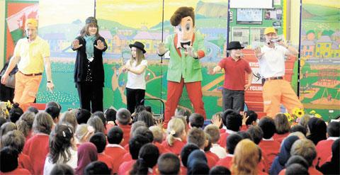 LITTER LESSON: The Gregory Brothers and Tidy Ted visited St Woolos Primary School and were helped by teacher Adele Parry and pupils Taylor Heard and Aaron Barber to get the recycling message across