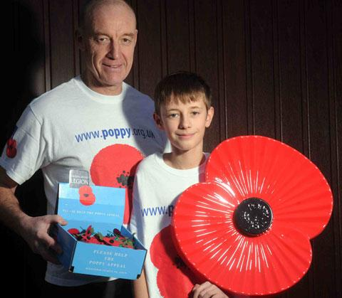 POPPY PUP: Gwent Poppy Appeal co-ordinator Mike Jones and his son Morgan who was 12 yesterday is signing up to the Royal British Legion making him one of the youngest members in Wales