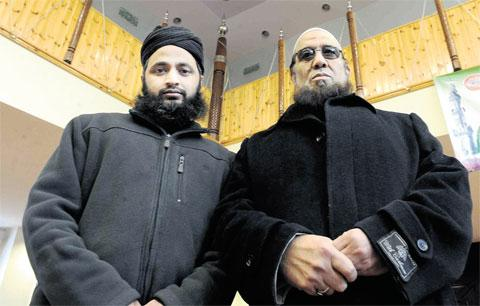 IN THEIR THOUGHTS: Imam Rafiqur Rehman, left, and Abdul Rehman Mujahid at the Jamia Mosque in Newport are among the many people in the community remembering the family killed in Saudi Arabia