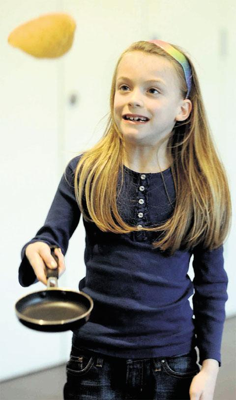 FLIPPING GREAT: Morgan Walters-Davies, of Tredegar, tosses a pancake at Bedwellty House pancake party, Tredegar