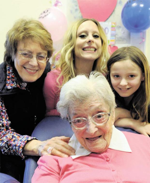 CELEBRATION: Gwen Howells celebrates her hundreth birthday with daughter Glenys Munkley, granddaughter Esther Munkley and great-granddaughter Kitty McCormick Celebrating centenary with smiles