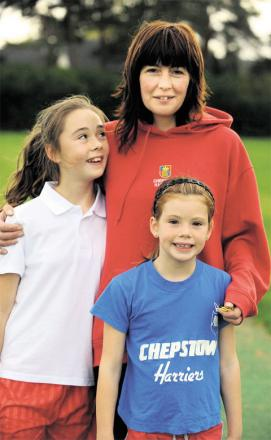 SURPRISED: Louise Summers, pictured with two of her children, Polly, left, and Ceri, says responsibility for any failing must be with the local authority, not with teachers