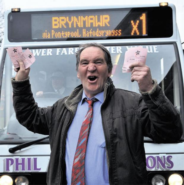 JUST THE TICKET: Phil Anslow ready to hand out Lottery tickets to passengers