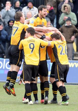 TEAM SPIRIT: Christian Jolley is mobbed after scoring against AFC Telford United on Saturday