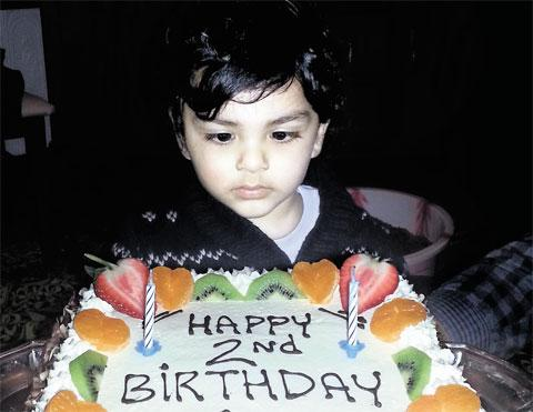 PLEA FOR JUSTICE: Mohammed Eisa Danial Hayat with a cake his family made him to mark his second birthday