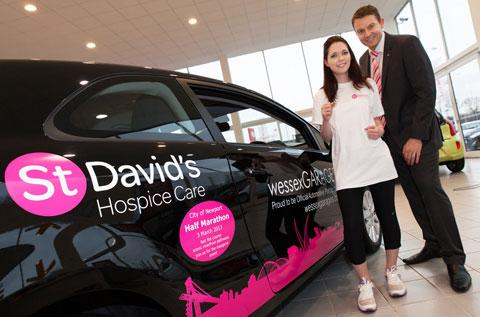 Natalie Halket with Kris Broome of St David's Hospice Care at Wessex Garages in Newport