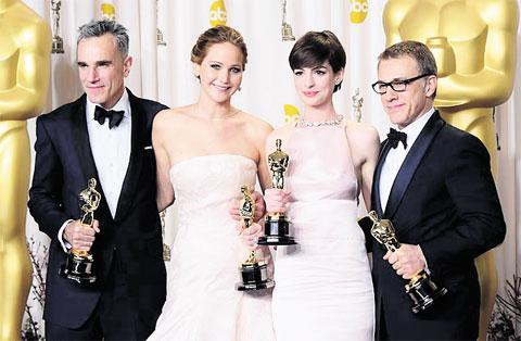 OSCARS GALORE AND NOT A BEARD TO BE SEEN: From left to right, Daniel Day-Lewis, Jennifer Lawrence, Anne Hathaway and Christopher Waltz with their Oscars