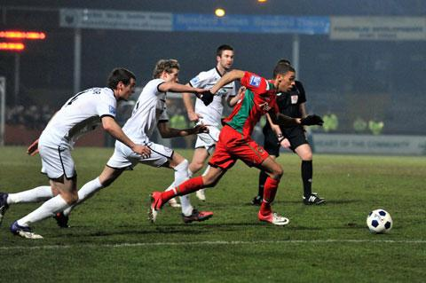 OLD RIVALS: County's Christian Jolley in action at Hereford in 2013