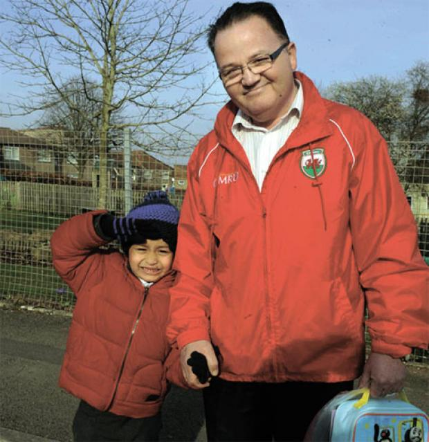 Nigel Hill and son John, six, a pupil at the school. Mr Hill says the children will be losing out, with less room to play