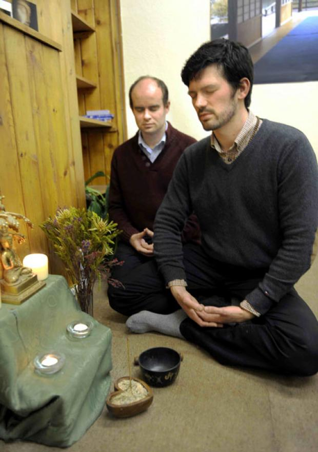 WEB SPACE: Buddhists William Elworthy (right) and Graham Shimell meditating in their workplace