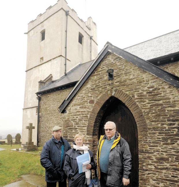 CONCERN: Clive Payne, Linday Payne and Henry Chivers outside St Tudor's Church in Mynyddislwyn