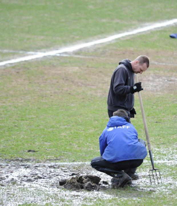 HUGE EFFORT: Rodney Parade groundstaff hard at work on Saturday. Picture by Sam Shingler