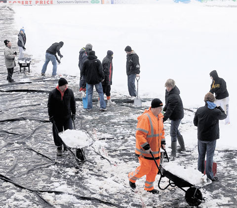 WEATHER WOES: County fans doing their bit to try to ensure matches go ahead