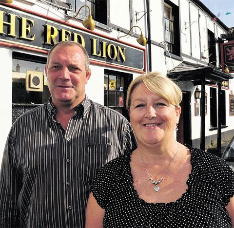 LICENCE CONDITIONS CHANGED: Angela Jones, licensee of the Red Lion, Caerleon, with husband Adrian Jones pictured last year