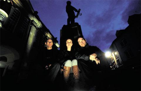 REGULAR HAUNT: Members of Ghost Watchers, from left, Richard Fry, Kelly Davies and Phil Jones by the statue of Charles Stewart Rolls in Agincourt Square, Monmouth