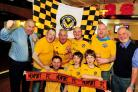 Newport County fans get in the mood for Sunday's trip to Wembley at the Riverside Tavern on Clarence Place with Landlord Mike Jones (front left)