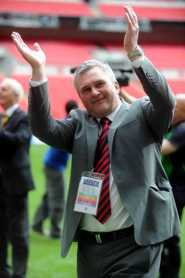 South Wales Argus: JOB DONE: Tim Harris celebrates promotion with Newport County at Wembley last year
