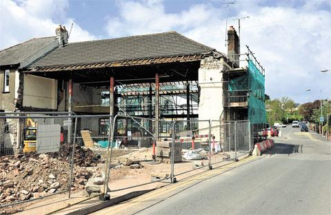 South Wales Argus: DEMOLITION: Work progresses to convert the former Angel Hotel into a Sainsbury's store