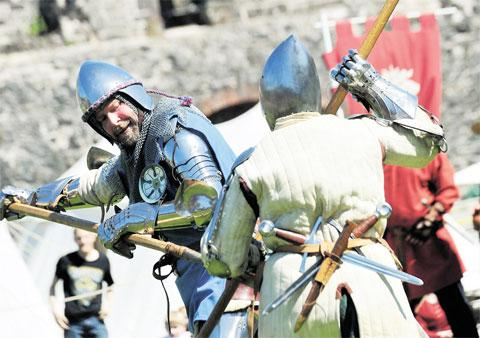 South Wales Argus: TAKE THAT! The Freemen of Gwent stage a battle inside Chepstow Castle at the medieval re-enactment event