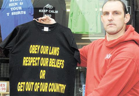ARREST THREAT: Matthew Taylor and the T-shirt police have forced him to remove from display