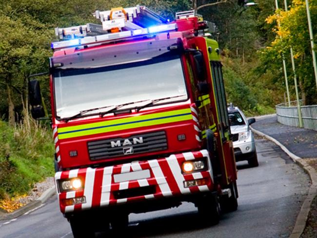 Firefighters tackling blaze at barn with gas cylinders