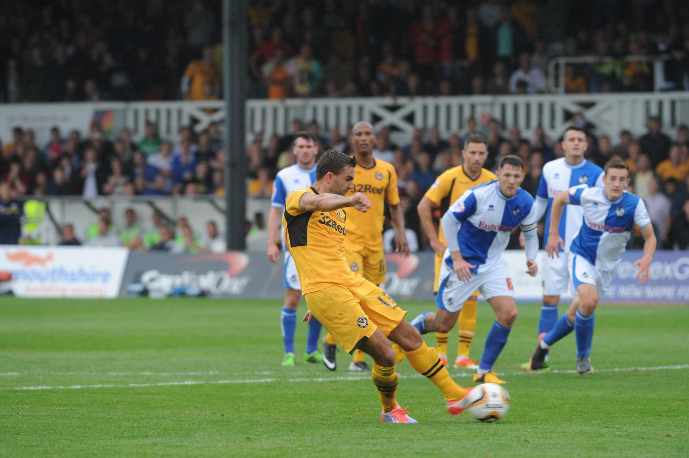 WINNER: Andy Sandell scores from the spot to beat his former club Bristol Rovers at Rodney Parade in Augu