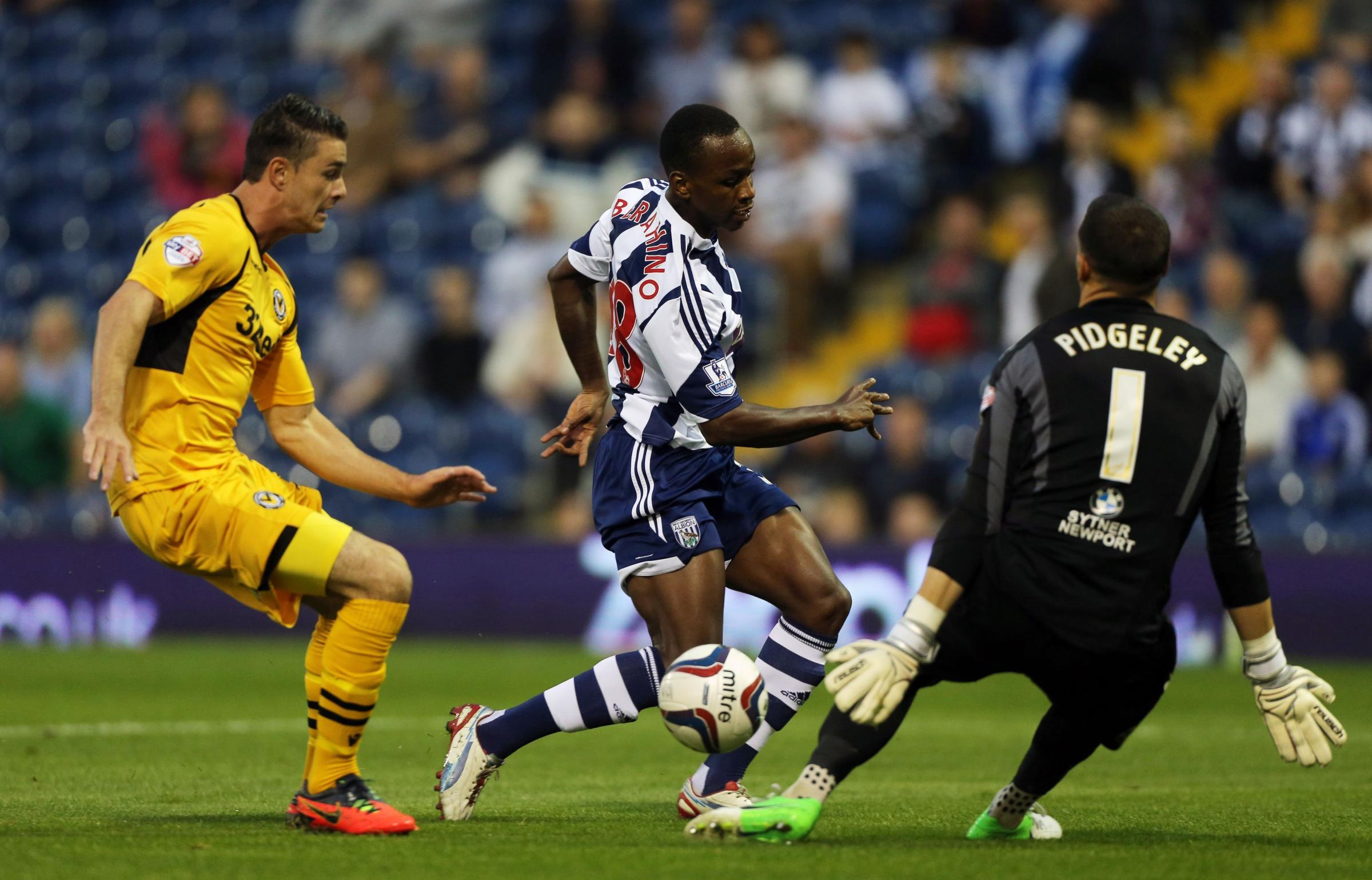 HAT TRICK HERO: West Bromwich Albion's Saido Berahino scores the opening goal beating Newport County goalkeeper Lenny Pidgeley during the Capital One Cup, Second Round match at The Hawthorns