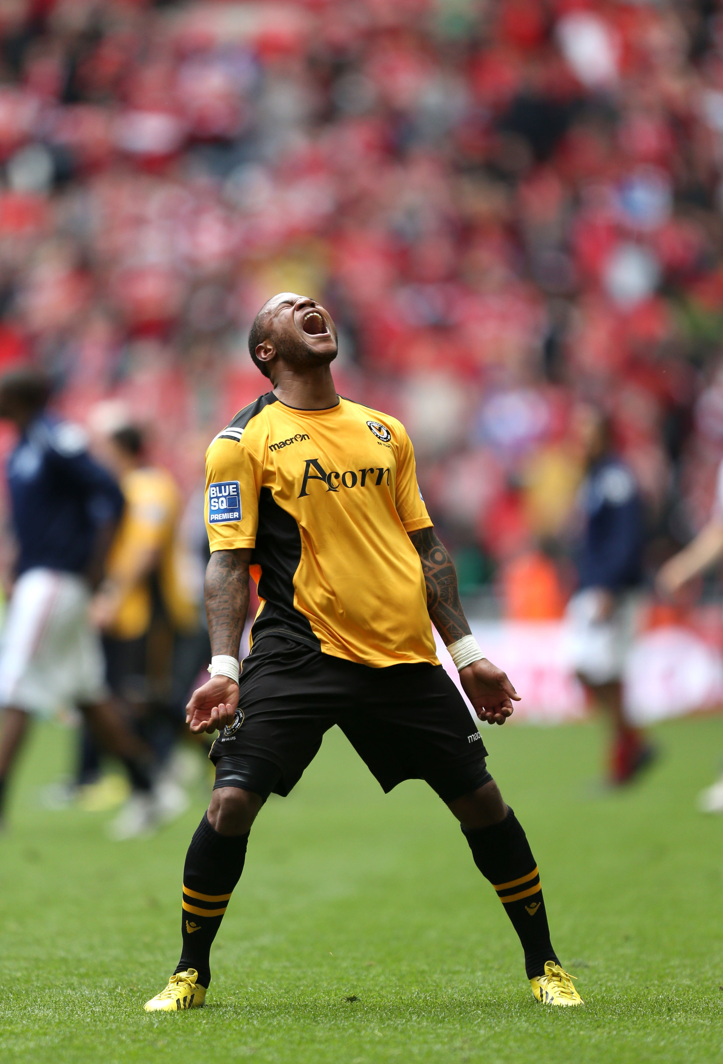 Newport County's Aaron O'Connor who scored their second goal of the game celebrates their victory after the Blue Square Premier League Play-Off Final at Wembley Stadium, London. PRESS ASSOCIATION Photo. Picture date: Sunday May 5, 2013. See PA sto