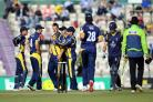 Glamorgan's Jim Allenby (third left) is congratulated by his team mates after taking the wicket of Hampshire's James Vince (second right) during the Clydesdale Bank Pro40 Semi Final match at the Ageas Bowl, Southampton. PRESS ASSOCIATION Photo. Pi