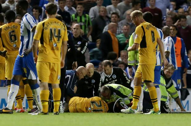 Newport's Byron Anthony is treated by medical staff during the Capital One Cup, First Round match at the AMEX Stadium, Brighton. PRESS ASSOCIATION Photo. Picture date: Tuesday August 6, 2013. See PA story SOCCER Brighton. Photo credit should read: Gar