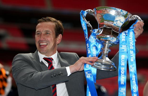 Newport County's manager Justin Edinburgh celebrates with the trophy during the Blue Square Premier League Play-Off Final at Wembley Stadium, London. PRESS ASSOCIATION Photo. Picture date: Sunday May 5, 2013. See PA story SOCCER Wrexham. Photo credit