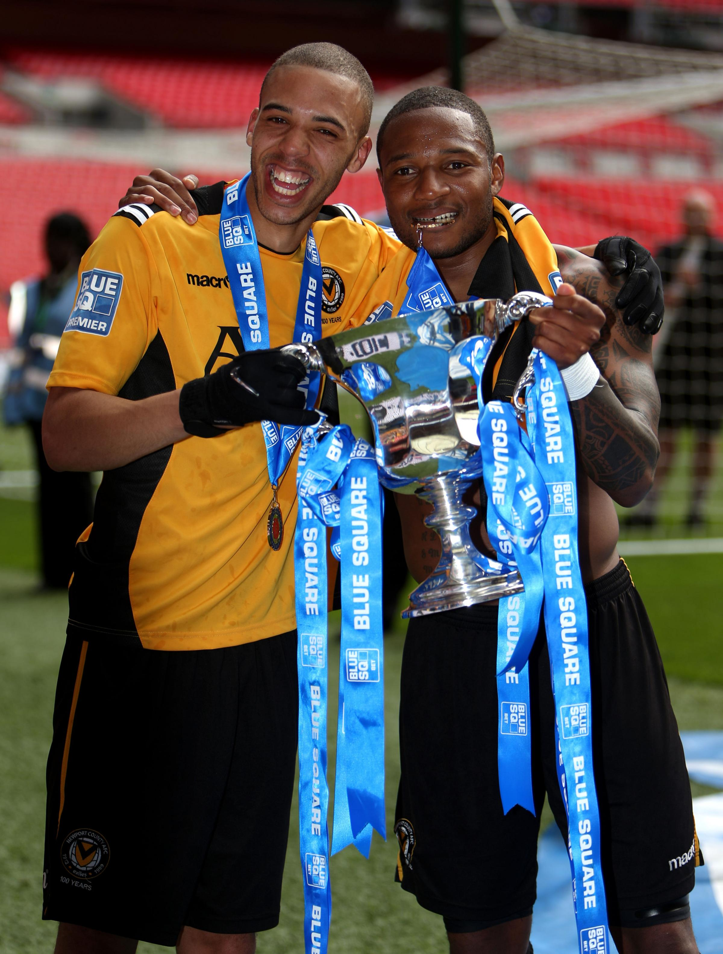 Newport County's goalscorers Christian Jolley (left) and Aaron O'Connor celebrate with the trophy during the Blue Square Premier League Play-Off Final at Wembley Stadium, London. PRESS ASSOCIATION Photo. Picture date: Sunday May 5, 2013. See PA st