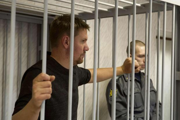 LOCKED UP: Anthony Perrett in a Russian court at an earlier hearing
