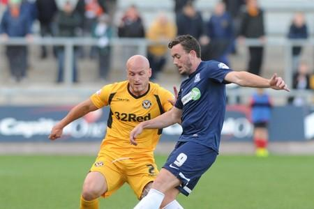 FORMER FAVOURITE: Craig Reid in action for Southend against County captain David Pipe in October
