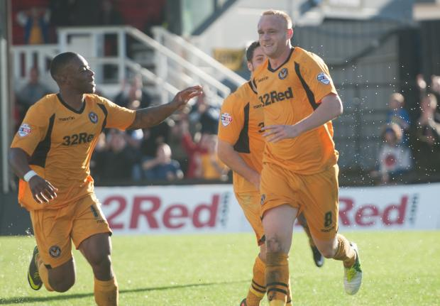 OLD FRIENDS: Lee Minshull, right, and Ryan Jackson both face their former club AFC Wimbledon tomorrow
