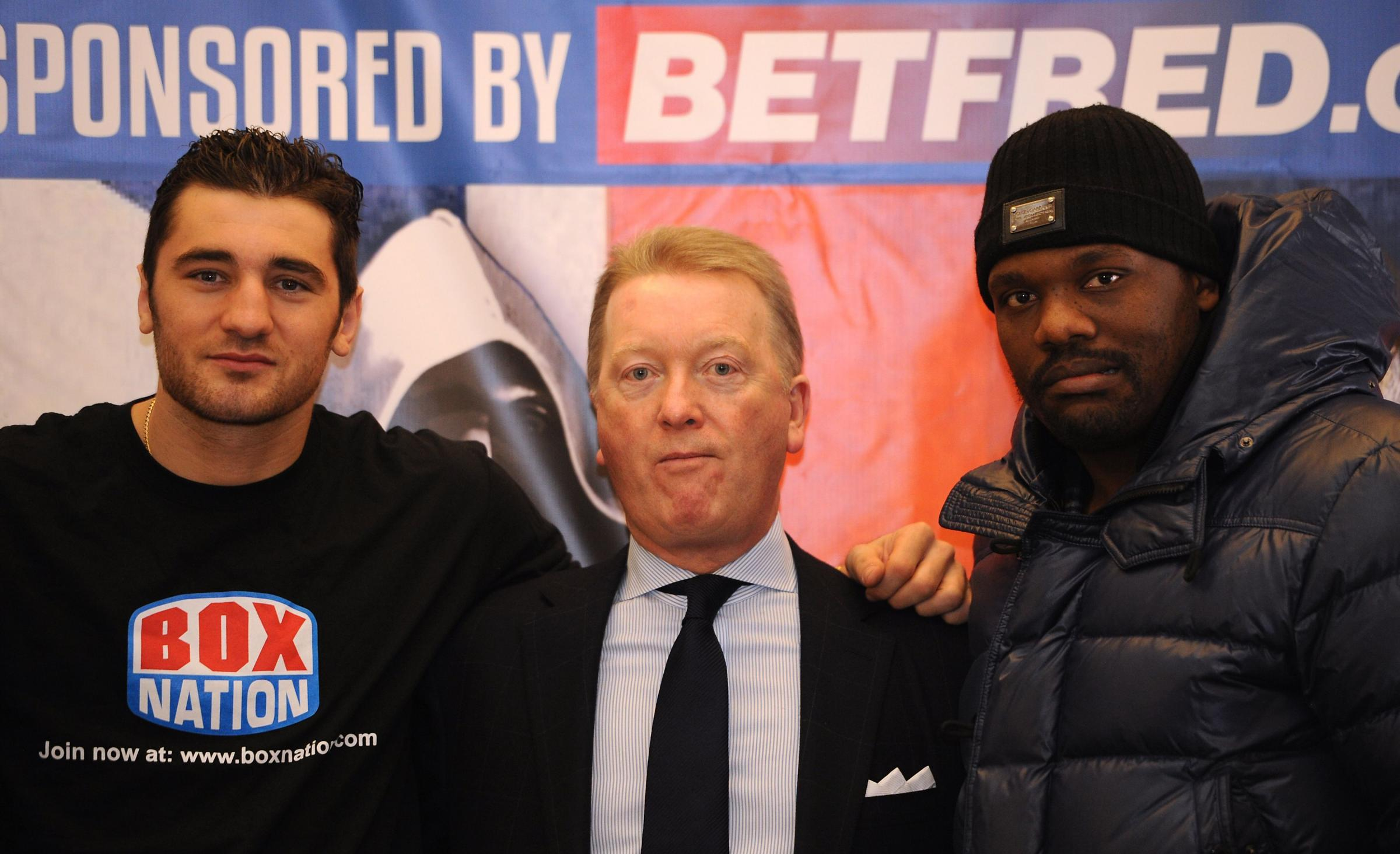 Promoter Frank Warren (centre) with WBO World Light-Heavyweight Champion Nathan