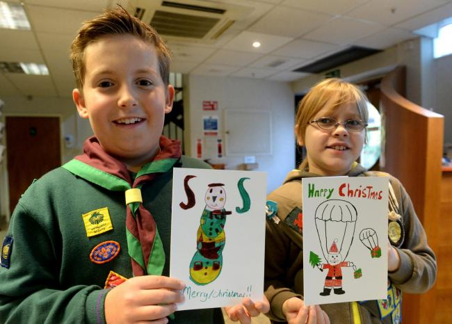 IN THE PICTURE: Two winners of the UK Support our Soldiers Christmas Card competition are from Gwent. Joel Williams and Chloe Boshier with their designs. (2394927)