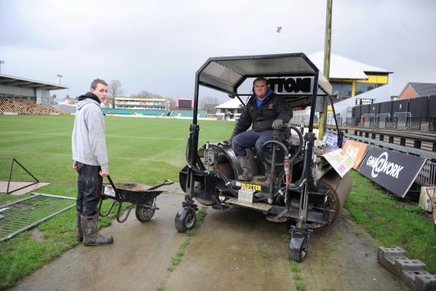 HARD WORK: Rodney Parade ground staff John Raymond and Nick Delahay with a Blotter machine this afternoon