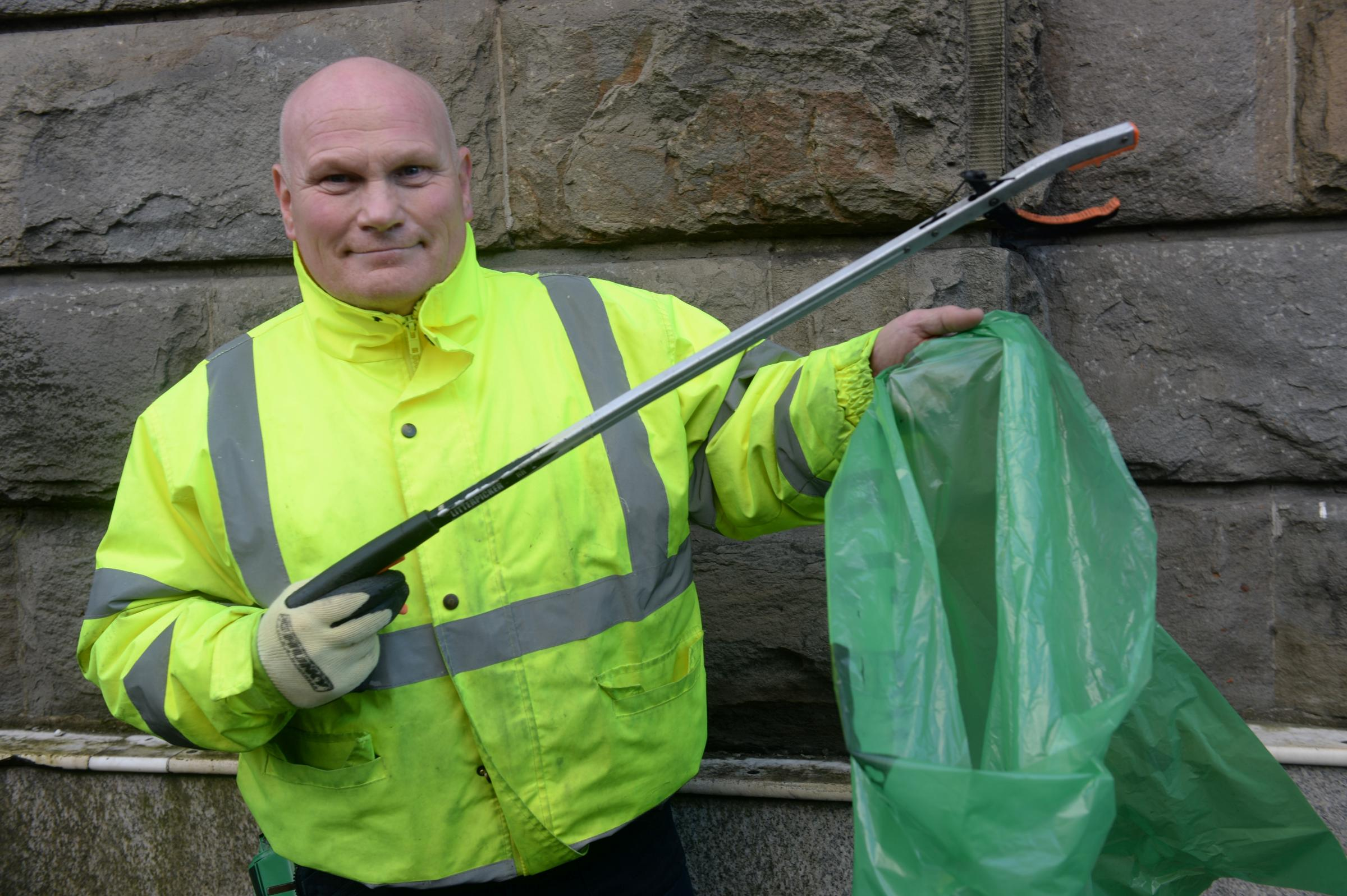 Keith Wright is to be awarded a BEM for cleaning the streets of Pontypool for 32 years. Pictured is Keith keeping the streets of Pontypool Town Centre clear of rubbish. (3219370)