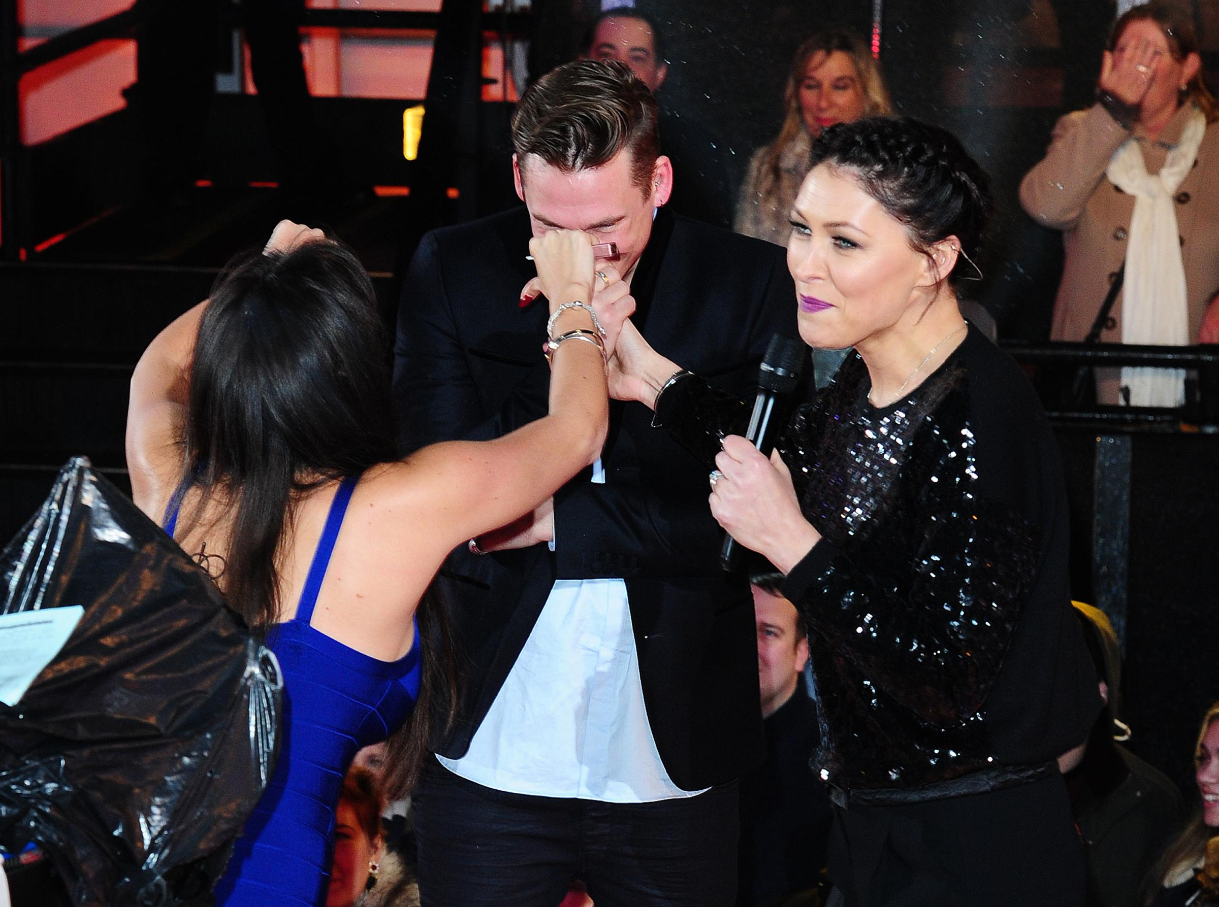 Casey Batchelor and Lee Ryan (with presenter Emma Willis, right) are evicted from the Celebrity Big Brother House at Elstree Studios in Borehamwood to a house called the bolt hole, before reentering the house on Friday. PRESS ASSOCIATION Photo. Picture da