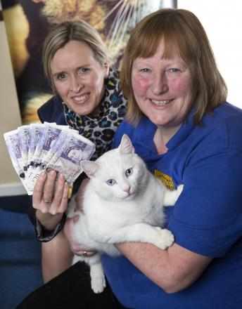 WINNER: Glynis Davies, leader of Gwent Cats Protection with Kellie Risdale, Taylor Wimpey sales manager. Pics (C) Huw John Photography, Cardiff.